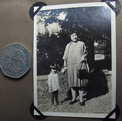 Vintage 1920s photograph Small girl with women wearing pleated skirt and shawl